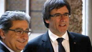 Enric Millo i Carles Puigdemont, al Palau de la Generalitat