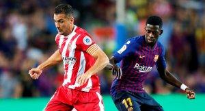 Granell i Dembélé, en una acció del partit entre el Barça i el Girona al Camp Nou.