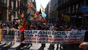 Imatge de la capçalera de la manifestació convocada per Jusapol a Barcelona