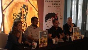Imatge de l'acte de presentació de llibre, amb Raquel Sans i Octavius a l'esquerra de la foto.