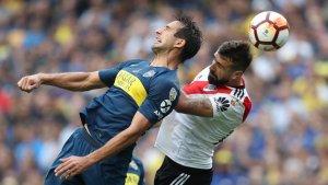 Boca Juniors i River Plate han empatat a dos gols en el primer round de la final, en un derbi tan increïble com vertiginós.