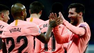 Messi celebra un dels seus dos gols contra l'Espanyol.