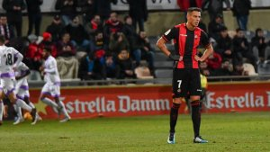 El Numancia celebra el gol amb Querol lamentant l'acció des de la distància