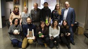 Imatge dels guanyadors del concurs amb membres del consistori de Sarral.