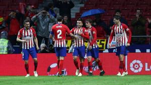 Els jugadors de l'Atlètic celebren un dels gols contra el València.