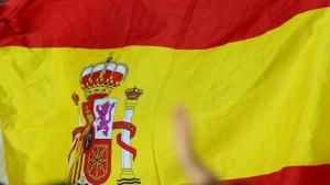 Aficionat culé amb una bandera d'Espanya