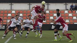 Perone i Rodríguez, rematant una acció del matx
