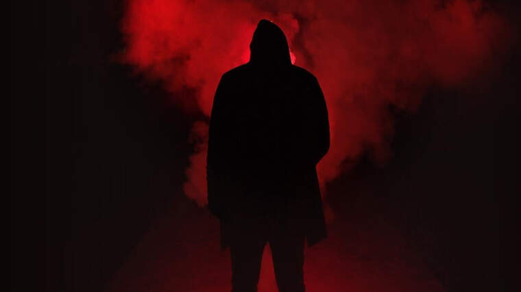 Man surrounded by red smoke
