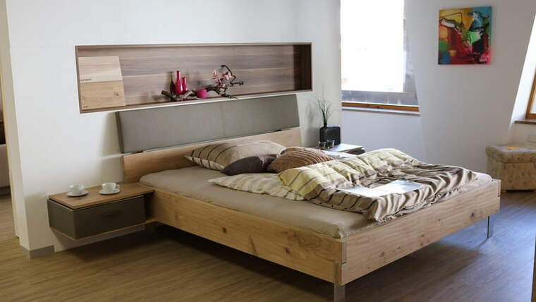 A bedroom with a wooden bed