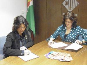 Mata i Vila signant el conveni per posar en marxa el SAI