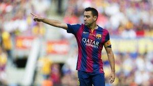 Xavi Hernández, amb la samarreta del Barça, al centre de la polèmica