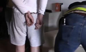 Un dels detinguts per la Policia Nacional, durant l'escorcoll de casa seva.