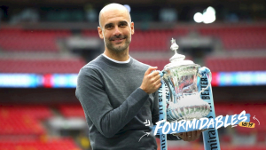 Pep Guardiola celebra els quatre títols del Manchester City aconseguits aquesta temporada
