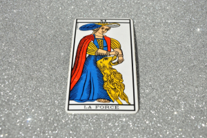 There is controversy as to the representation of the Strength tarot card by a woman.