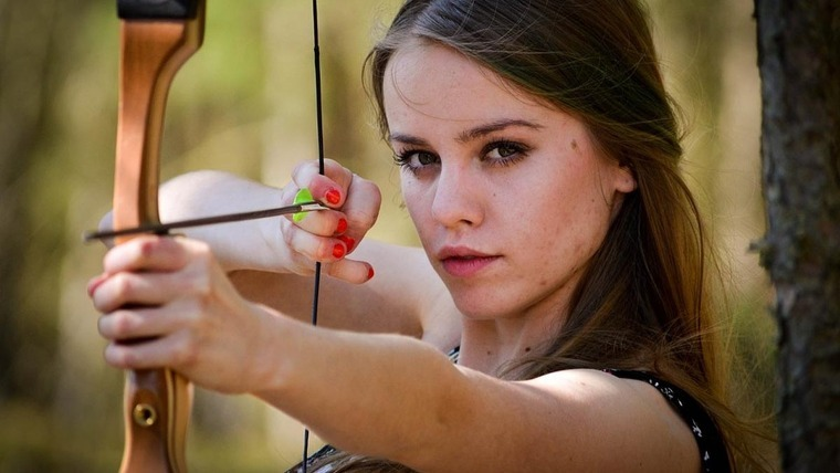woman with a bow and an arrow