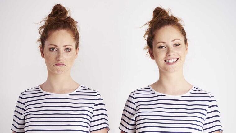 Twins: one sad and one happy.