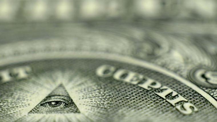 A part of a US dollar bill with the Illuminati symbol on it.