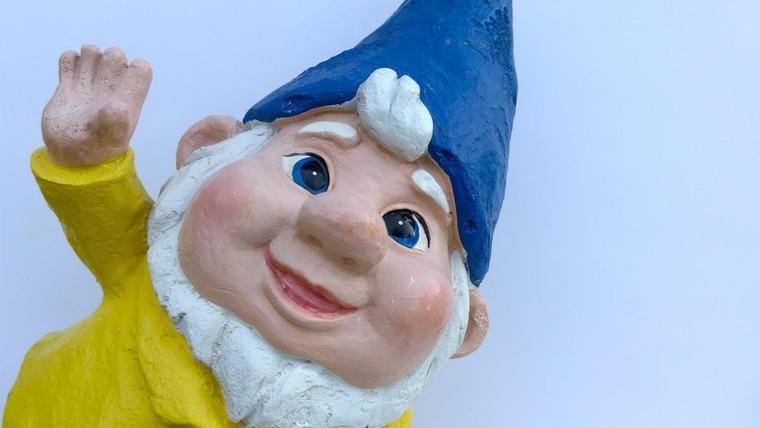 A gnome waving