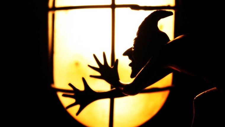 An imp's shade with a light in the background