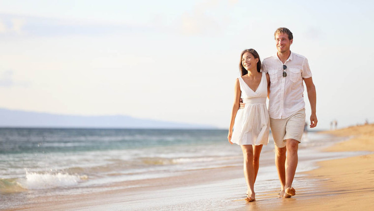 A couple walking on the beach