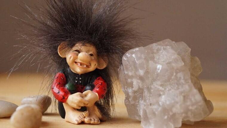 A troll next to a gemstone