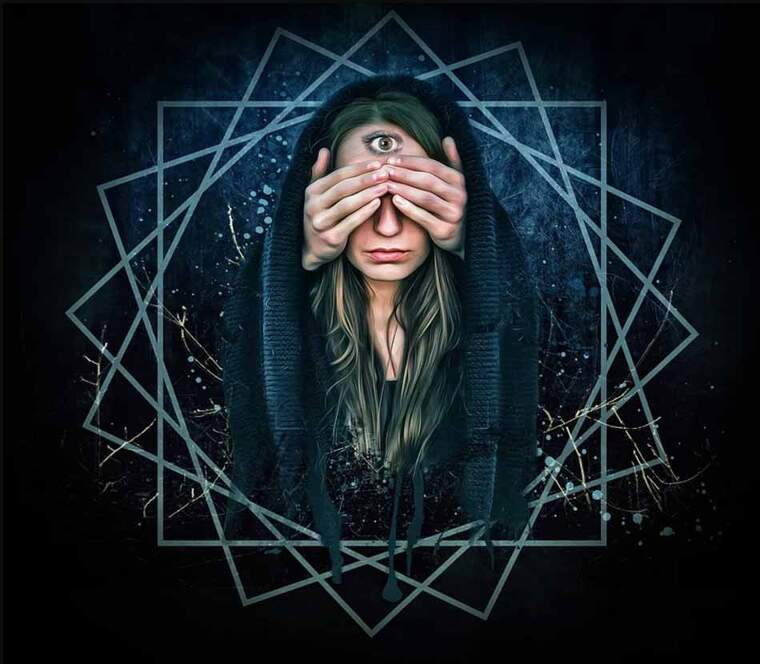 A woman with a hud with her eyes covered and a third eye on her forehead