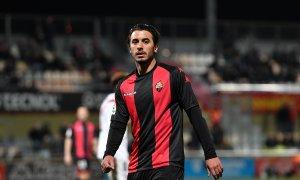 Guzzo ha vestit de roig-i-negre durant dues temporades.