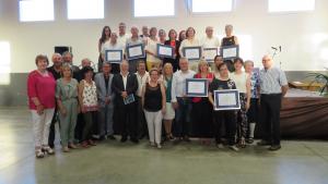 Imatge de vuit dels premiats pel Mèrit de Serveis Distingits.