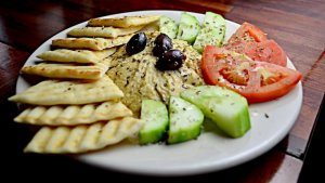 Hummus can be eaten with bread or different kind of vegetables.