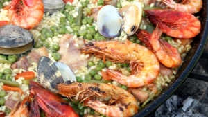 Seafood paella is a famous dish that uses various types of crustaceans and mollusks |