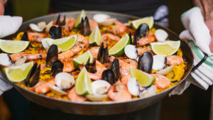 Learn how to make seafood paella.