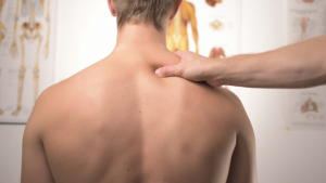 Among other things, the chiropractor applies pressure to the spine to relieve certain musculoskeletal ailments.