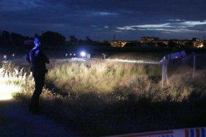 Agents dels Mossos al barri de la Bordeta, a Lleida, on s'ha produit el tiroteig mortal.
