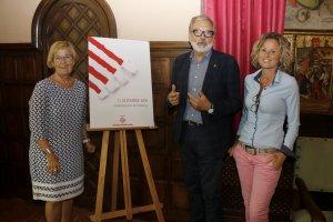 Pla obert on es pot veure l'alcalde de Lleida, Fèlix Larrosa, acompanyat per Montse Mínguez i Montse Parra