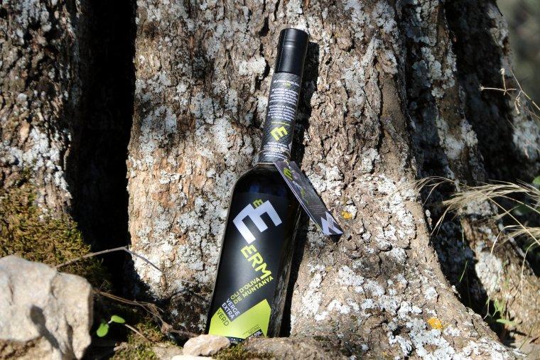 Imatge general d'una ampolla d'oli Erm verge extra d'oliva verda