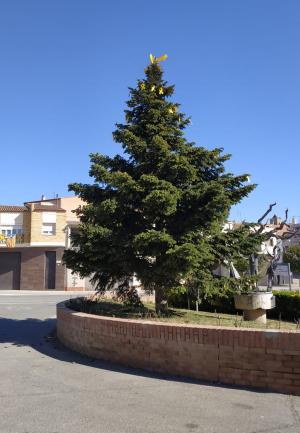 Un arbre amb llaços grocs a Corbins