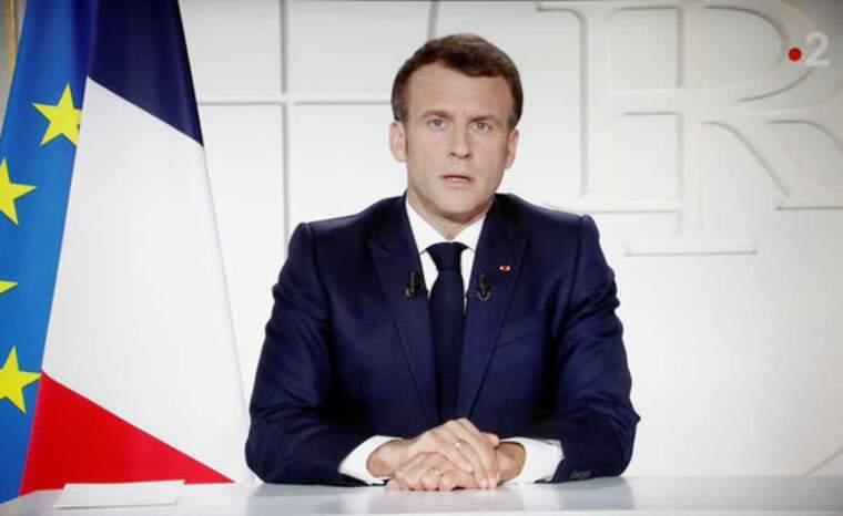 Pla mig del president de França, Emmanuel Macron, durant un discurs adreçat a la nació en què anuncia el tancament d'escoles