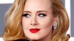 Adele luce el peinado ideal para cara redonda.